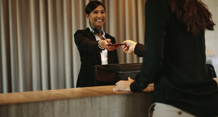 hotel employee gives guest a key card